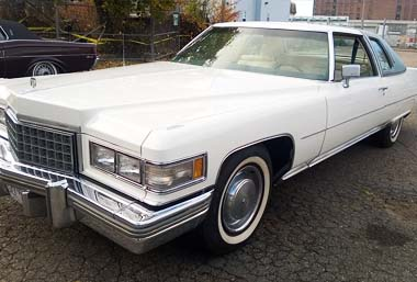 76 white cadillac coupe deville