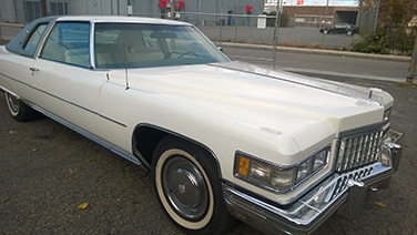 1976-cadillac-coupe-deville-front-side